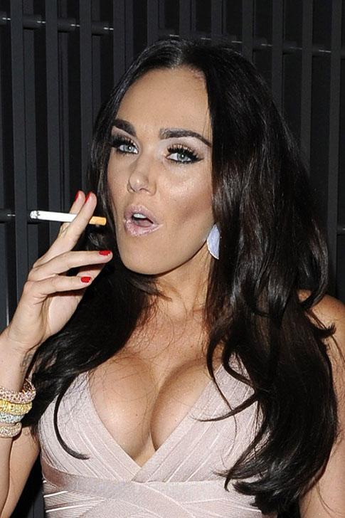 Sexy babe smokes cigarette through pussy 1